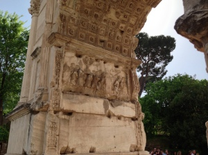 Detail in the Arch of Titus, depicting the treasures of the Temple in Jerusalem being carried away in victory.