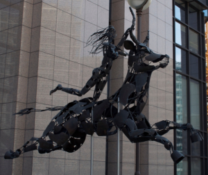 Sculpture, outside EU offices in Brussels, of Europa riding the bull -- reminiscent of a certain woman riding a beast (cf. Rev. 17:3)